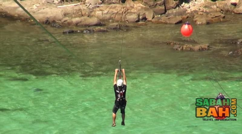 Zipline action in the TAR Park Kota Kinabalu - Coral Flyer